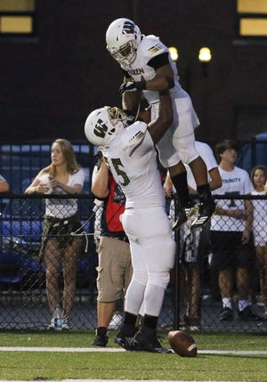Warren Central?s Romeir Elliott was hoisted in the air by teammate Justin Britt after scoring against Trinity at Trinity High School.