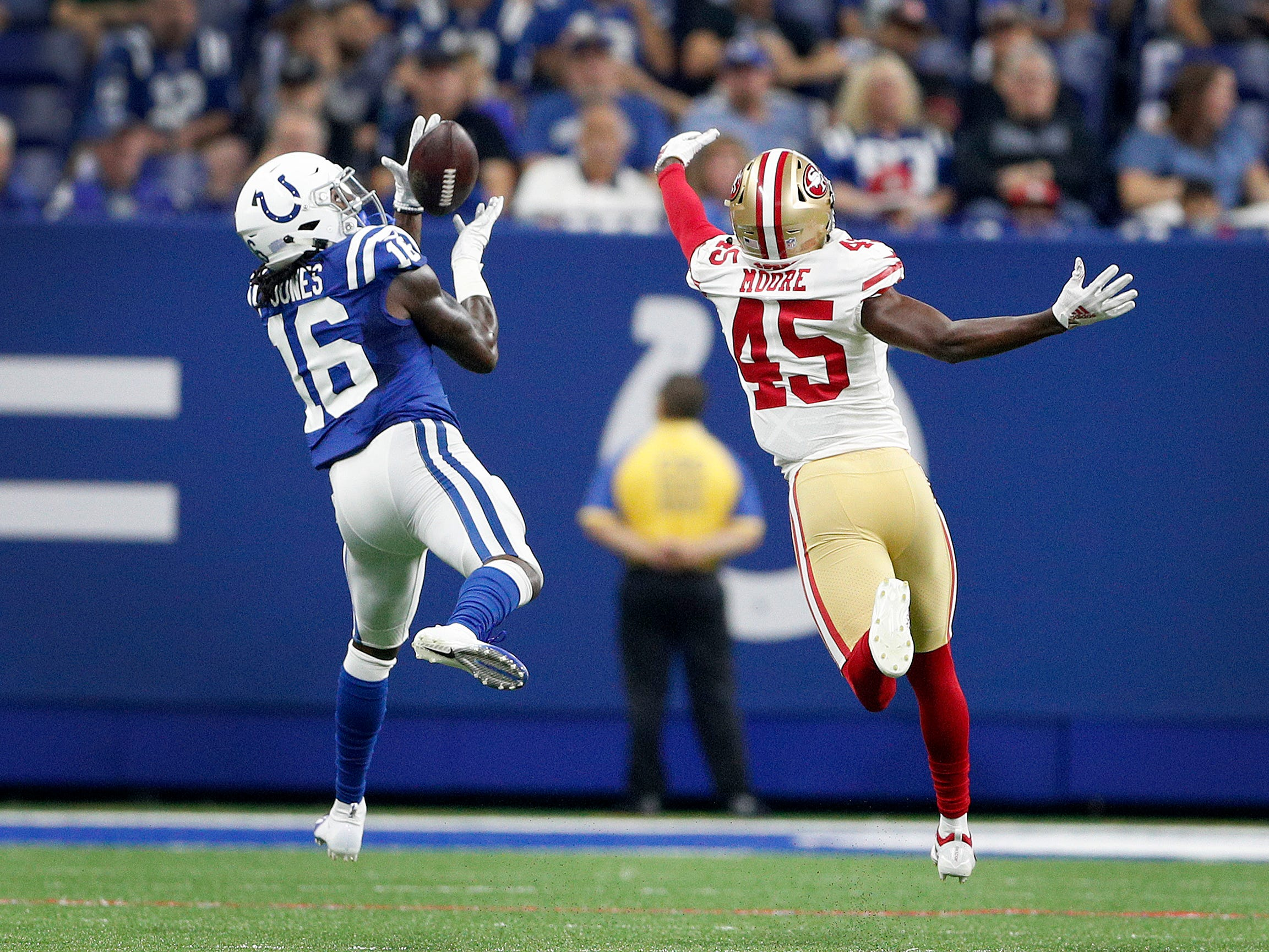 Indianapolis Colts wide receiver Seantavius Jones (16) hauls in a long pass from Jacoby Brissett burning San Francisco 49ers defensive back Tarvarius Moore (45) in the second half of their preseason football game at Lucas Oil Stadium Saturday, August 25, 2018. The Colts defeated the 49ers 23-17.