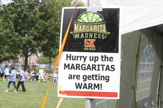 Motivational signs at the finish line of the Margarita Madness 5K in Indianapolis.