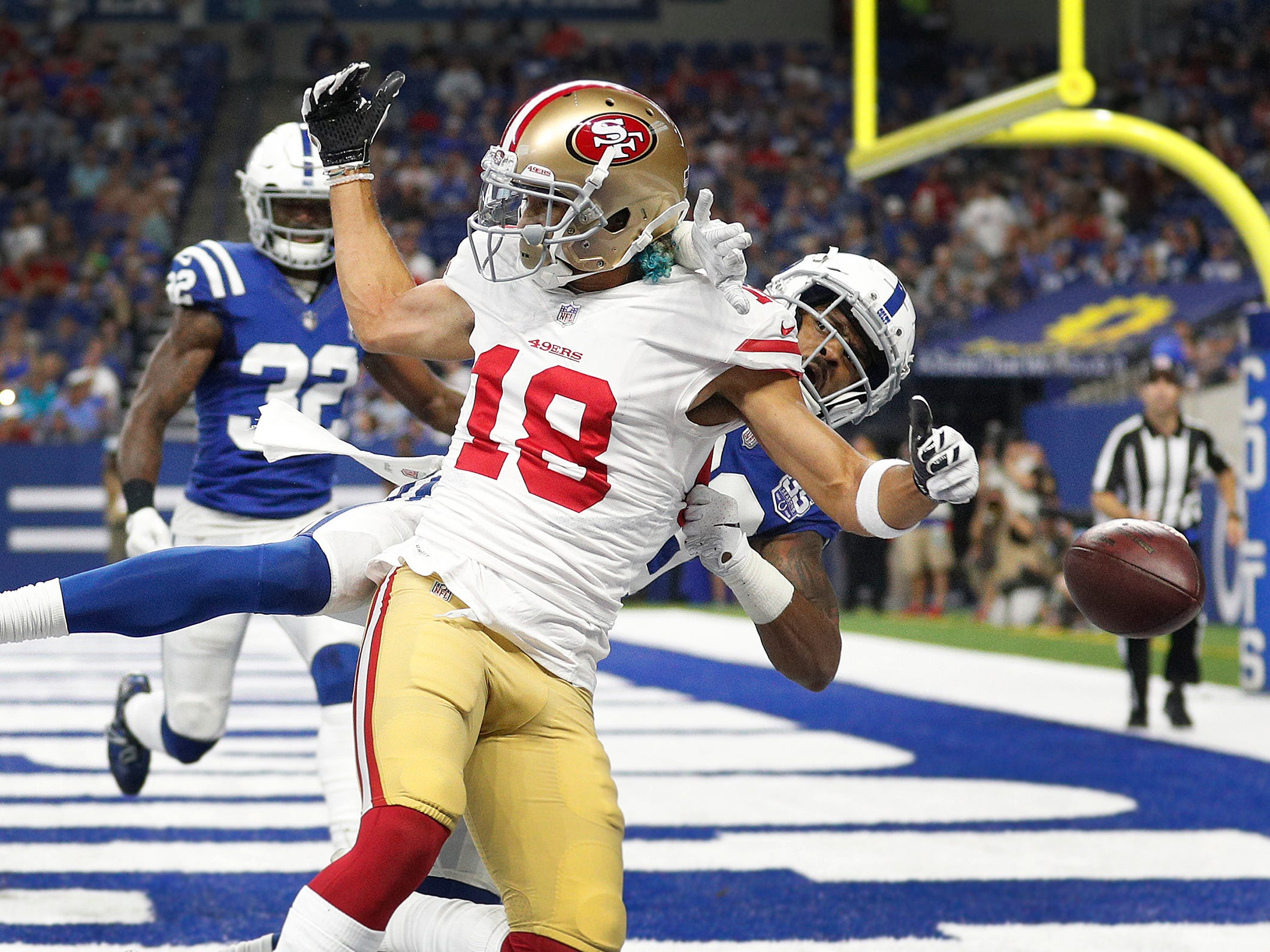 Indianapolis Colts cornerback Chris Milton (28) breaks up the pass intended for San Francisco 49ers wide receiver Dante Pettis (18) in the second half of their preseason football game at Lucas Oil Stadium Saturday, August 25, 2018. The Colts defeated the 49ers 23-17.