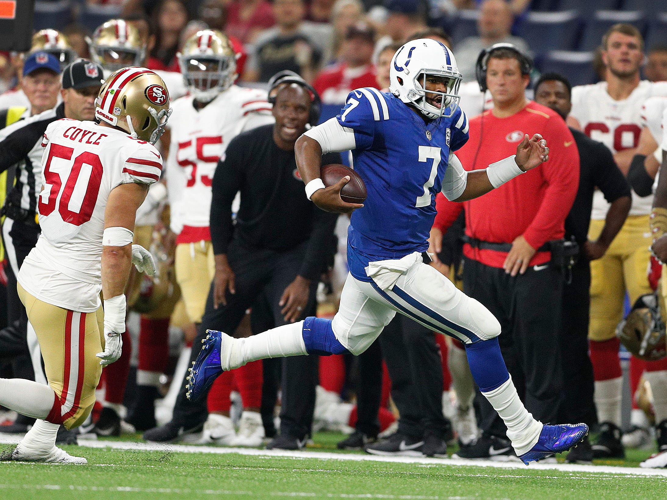 Indianapolis Colts quarterback Jacoby Brissett (7) runs away from San Francisco 49ers linebacker Brock Coyle (50) in the second half of their preseason football game at Lucas Oil Stadium Saturday, August 25, 2018. The Colts defeated the 49ers 23-17.