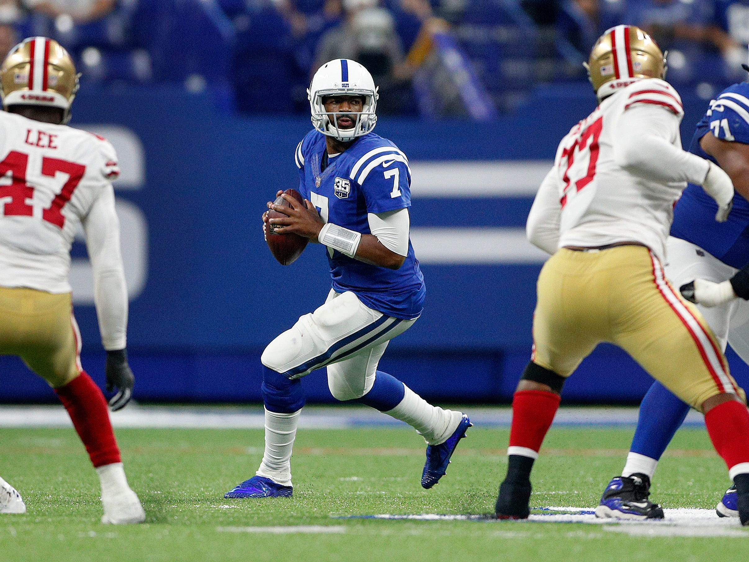 Indianapolis Colts quarterback Jacoby Brissett (7) drops back to pass on the San Francisco 49ers defense in the second half of their preseason football game at Lucas Oil Stadium Saturday, August 25, 2018. The Colts defeated the 49ers 23-17.
