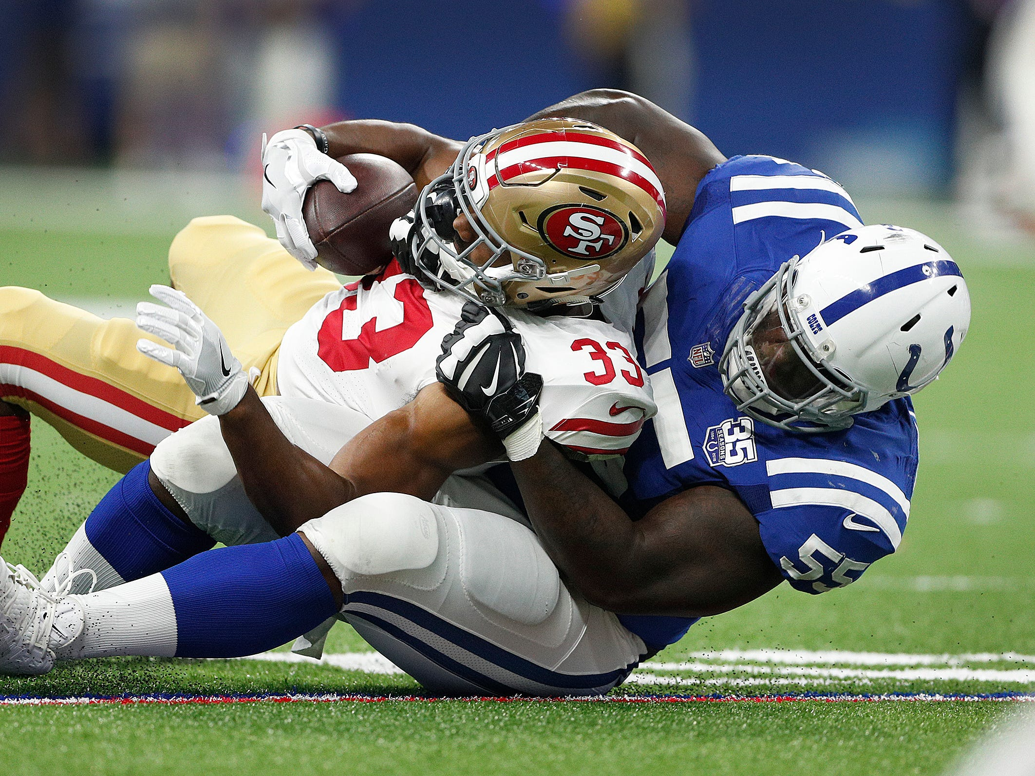 Indianapolis Colts defensive end Rakeem Nunez-Roches (55) tackles San Francisco 49ers running back Jeremy McNichols (33) in the second half of their preseason football game at Lucas Oil Stadium Saturday, August 25, 2018. The Colts defeated the 49ers 23-17.