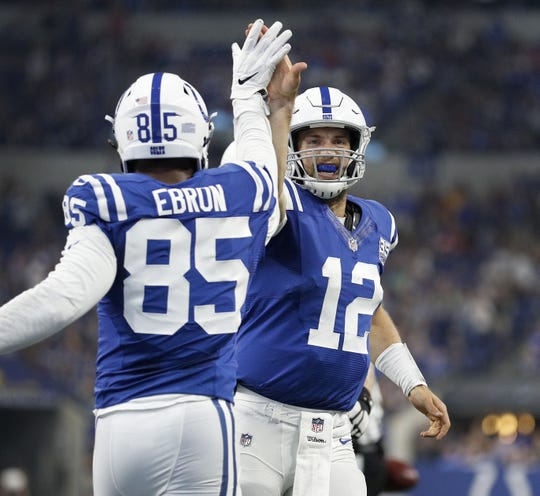 Indianapolis Colts tight end Eric Ebron (85) celebrates his touchdown with Andrew Luck (12) in the first half of their preseason football game at Lucas Oil Stadium Saturday, August 25, 2018.