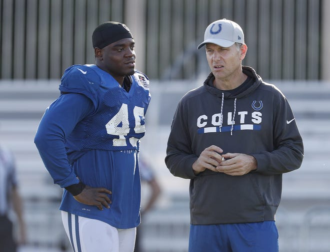 FILE -- Indianapolis Colts defensive coordinator Matt Eberflus talks with linebacker Matthew Adams (49) during the Colts training camp at Grand Park in Westfield on Monday, August 6, 2018.