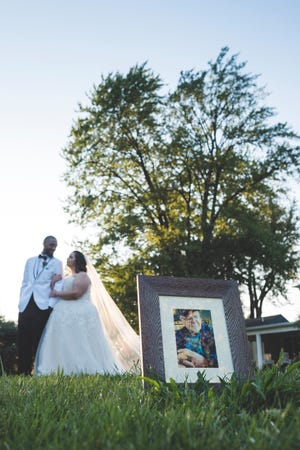 Tracy Davis and Duran Pugh were treated to a wedding photo shoot five years after their wedding. Pictured in the foreground is Davis' grandfather, Ron Babb.