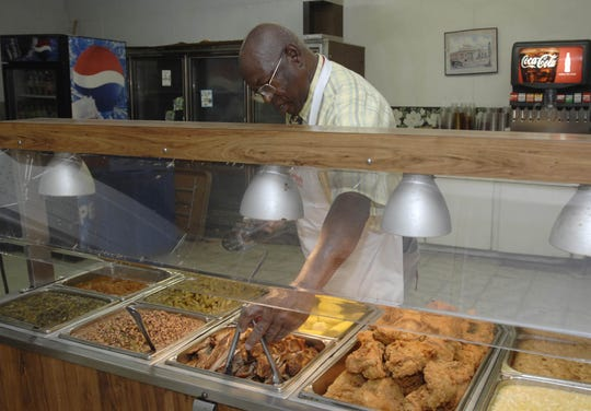 Owner and chef Arthur Davis says his fried chicken and homestyle buffet keep customers coming back to the Old Country Store Restaurant in Lorman, just a few miles down US 61 from Port Gibson.