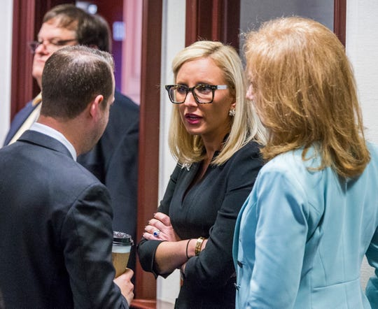 """File - In this March 6, 2018, file photo Florida Sen. Lauren Book (D-Plantation), center, speaks with Rep. Jared Even Moskowitz (D-Coral Springs), left, and Rep. Kristin Diane Jacobs (D-Coconut Creek) on the House floor in Tallahassee, Fla. The Florida legislative session was thrown into a chaotic final two weeks as lawmakers scrambled to pass a school safety bill in response to a shooting that killed 17 people at a Parkland high school. Book, whose constituents were affected by the shooting, said that's only partly to blame for the demise of sexual harassment legislation. She also cited """"political games"""" and an """"old boy"""" culture at the Capitol.  (AP Photo/Mark Wallheiser, File)"""