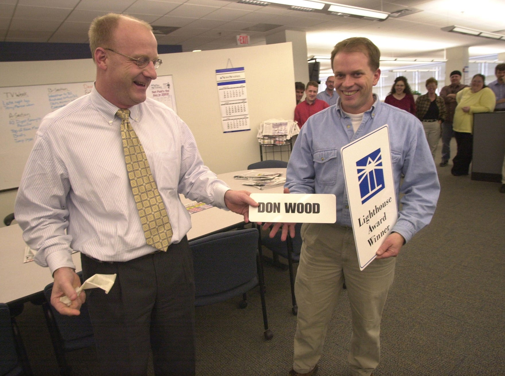 Publisher Bruce Hartmann, left, welcomes graphic artist Don Wood into the Scripps Howard Hall of Fame during a ceremony in 2003 at the News Sentinel in Knoxville. In addition, Wood received the first News Sentinel Lighthouse Award.