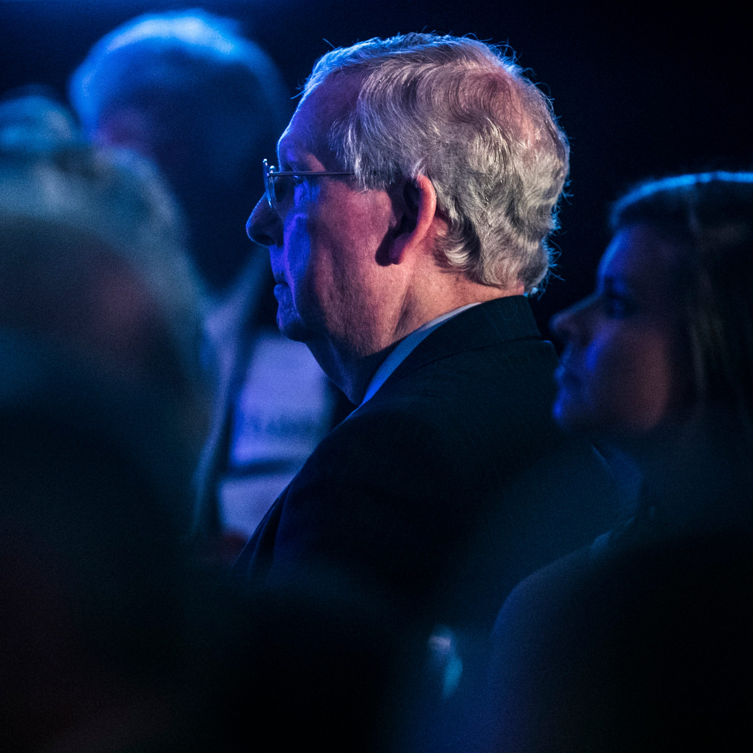 Sen. Mitch McConnell listens to Gov. Matt Bevin's speech at the dinner for Kentucky Republicans at the annual Lincoln Dinner in Lexington Saturday night. Aug. 25, 2018