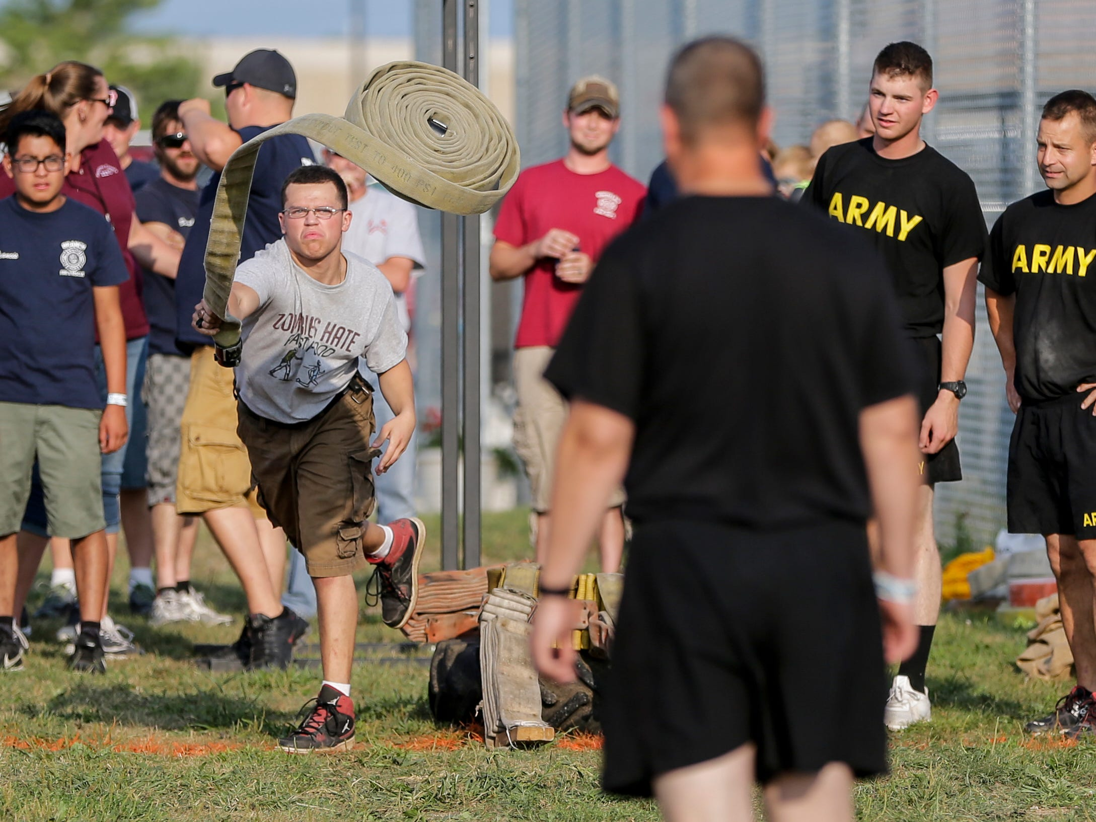 Pvt. Erik Janssen of team Army participates in a fire hose rolling contest at the Manitowoc County Fair Saturday, August 25, 2018, in Manitowoc, Wis. Josh Clark/USA TODAY NETWORK-Wisconsin