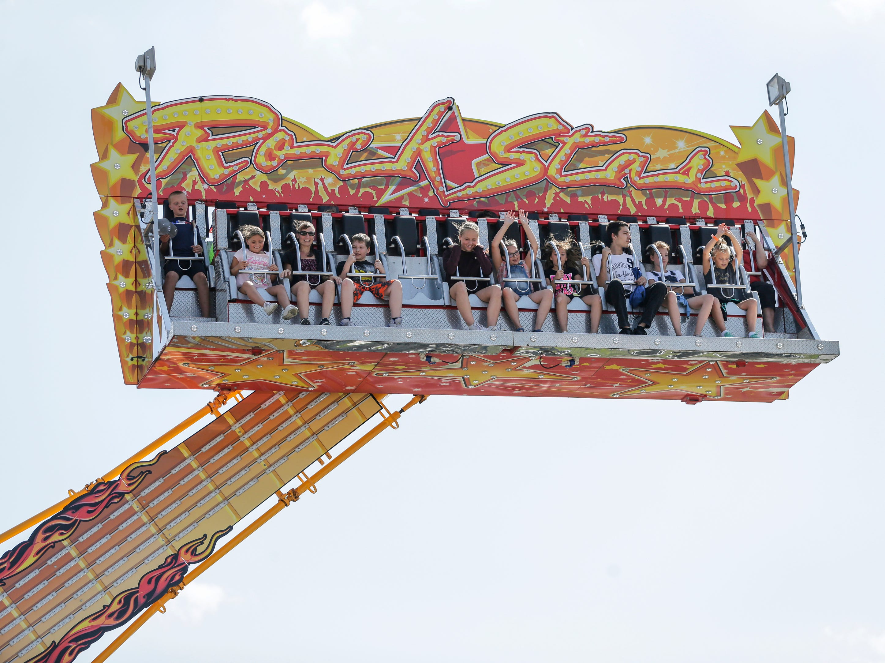 A ride thrills people at the Manitowoc County Fair Thursday, August 23, 2018, in Manitowoc, Wis. Josh Clark/USA TODAY NETWORK-Wisconsin