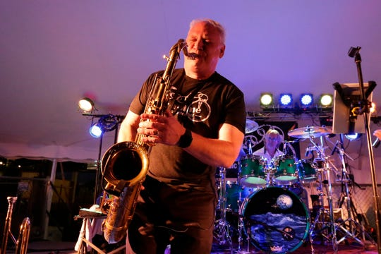 Kevin Van Ess wails on the sax as Out-A-Time performs at the Manitowoc County Fair on Aug. 22, 2018, in Manitowoc.