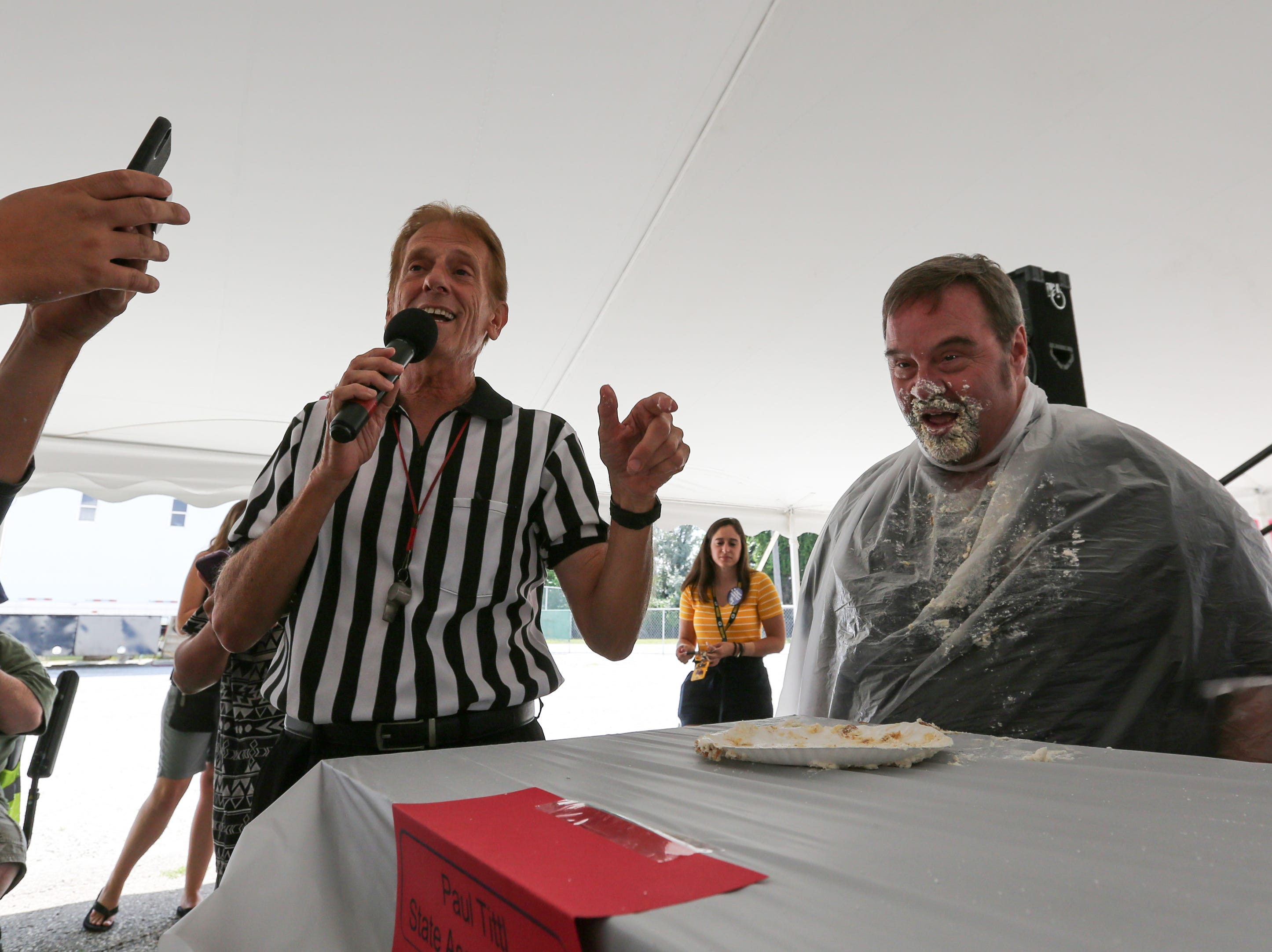 State Rep. Paul Tittl, right, wins the cream puff eating contest at the Manitowoc County Fair Thursday, August 23, 2018, in Manitowoc, Wis. Josh Clark/USA TODAY NETWORK-Wisconsin