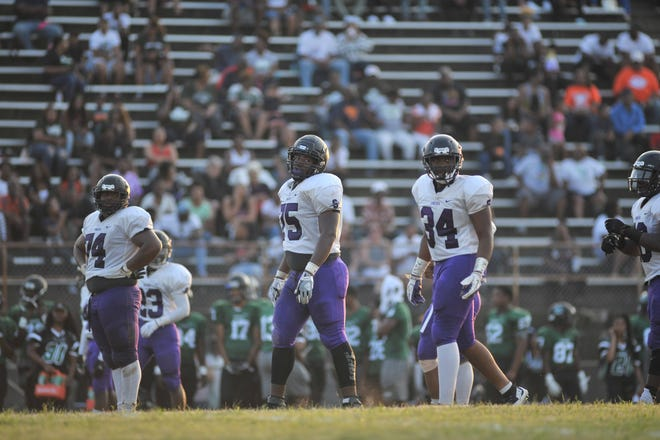 Southwind DT Kristian Williams (middle, No. 75) with his teammates against Cordova on Aug. 25