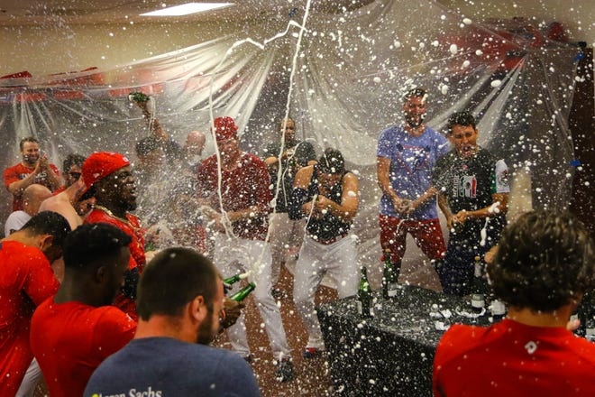Memphis Redbirds players celebrate their 2018 American Southern Division title in the locker room.