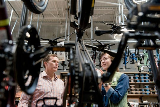 John Ozier, left, listens to an employee talk about REI's bike selection. The outdoor recreation store opened this weekend in Memphis