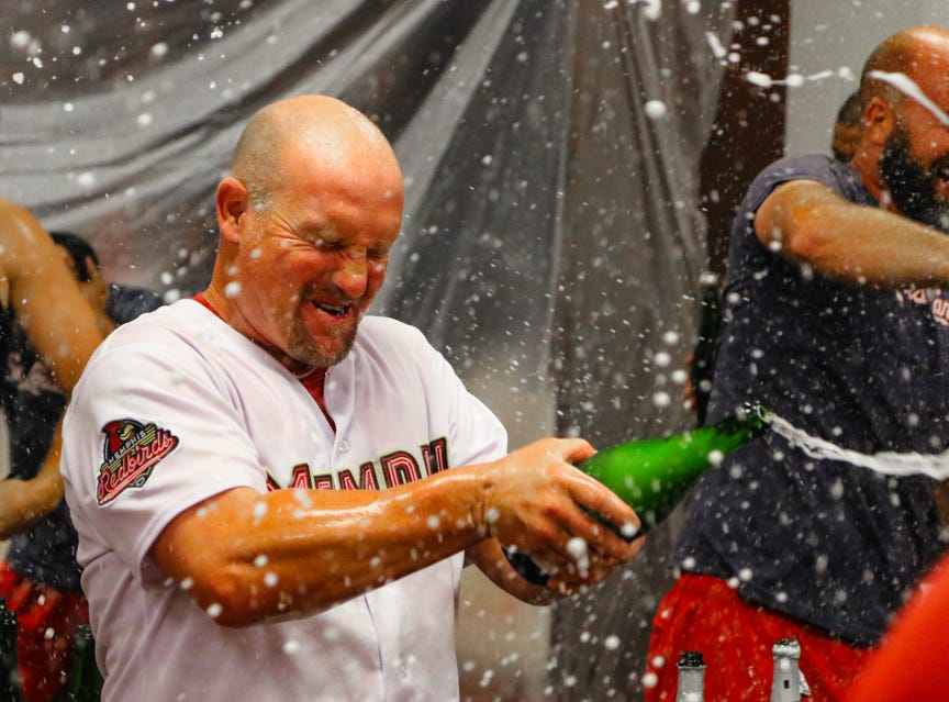 Memphis Redbirds manager Stubby Clapp celebrates American Southern Division title.