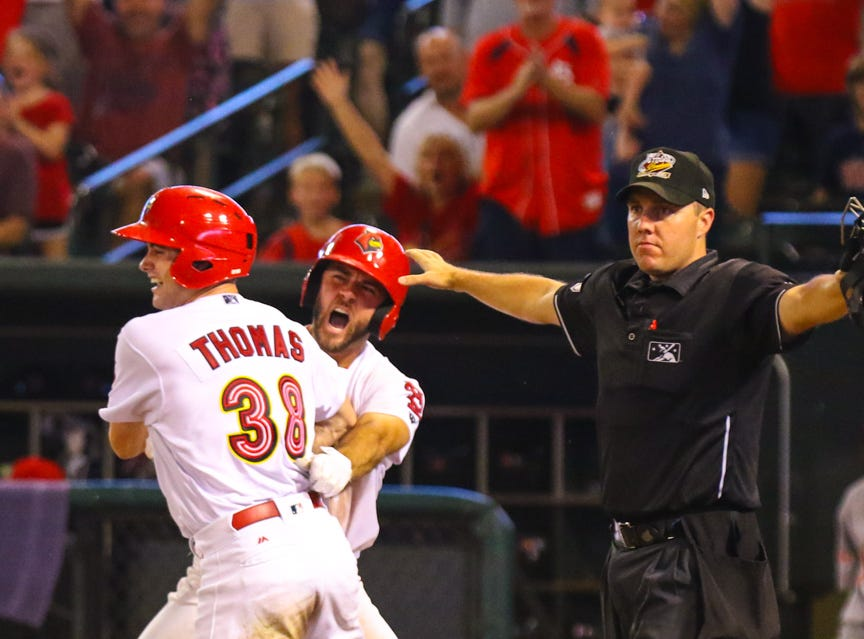 Lane Thomas crosses home plate in the Memphis Redbirds' walk-off win.