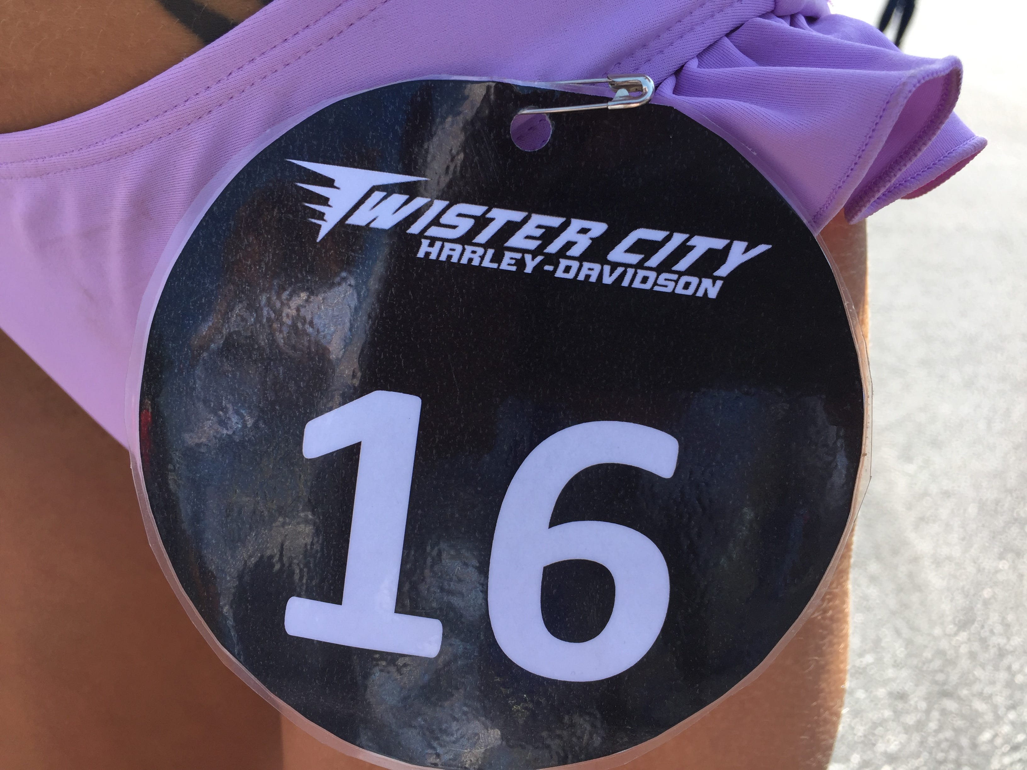 Closeup of Jenny Figueroa's number that customers could use if they wanted to vote her in as a model for the Twister City Harley-Davidson annual calendar.
