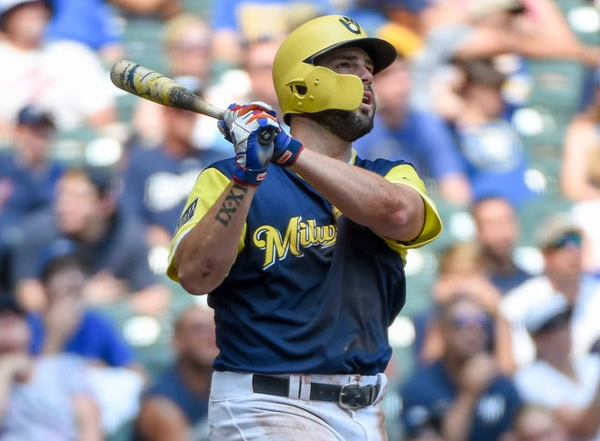 Aug 26, 2018; Milwaukee, WI, USA;  Milwaukee Brewers third baseman Mike Moustakas (18) hits a 2-run homer in the third inning against the Pittsburgh Pirates at Miller Park. Mandatory Credit: Benny Sieu-USA TODAY Sports