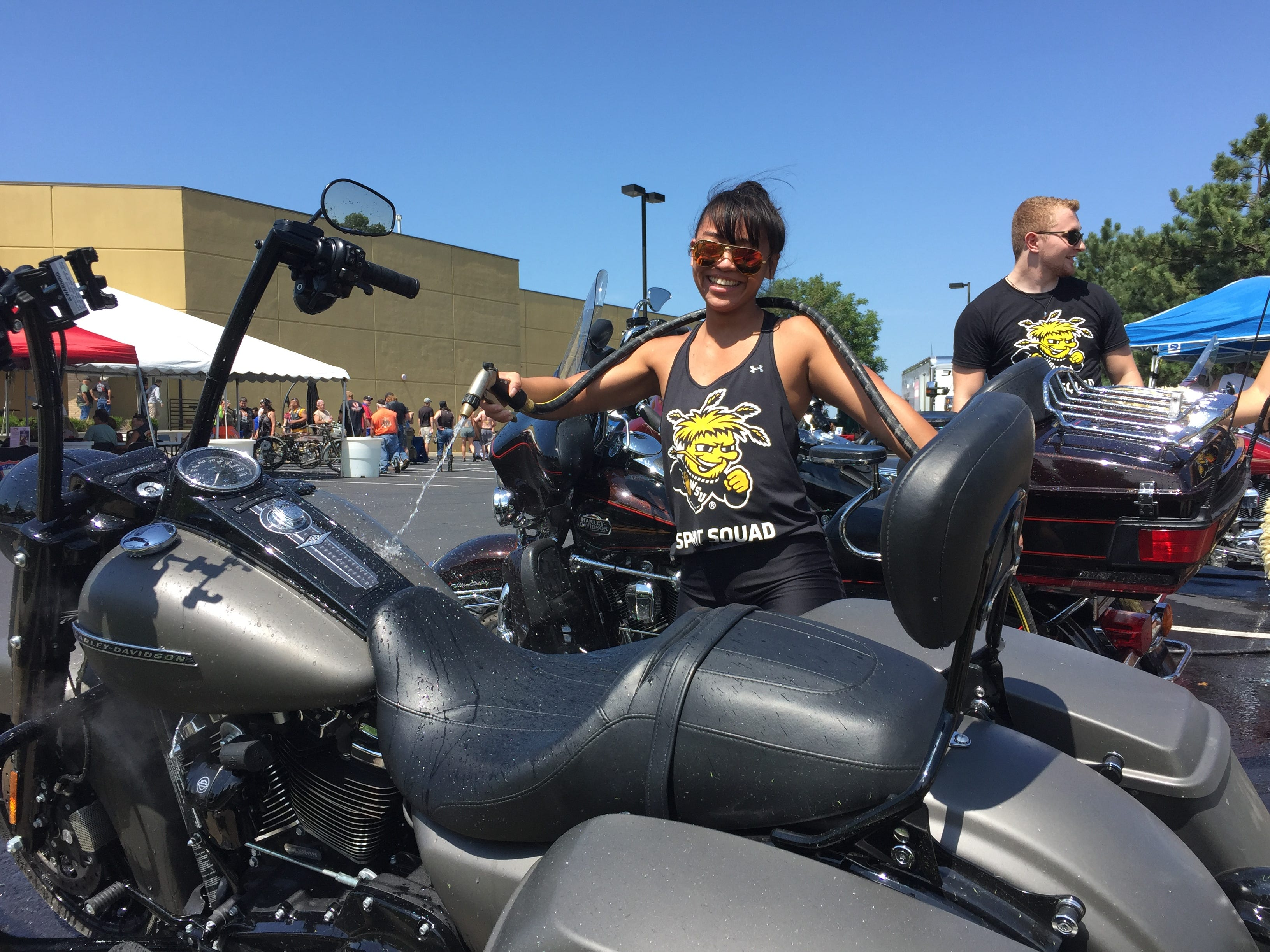 Elisa Bunting, 21, washes a bike at the Twister City Harley-Davidson Dealership in Park City, Kansas. Donations were used to support the Wichita State University Spirit Squad.