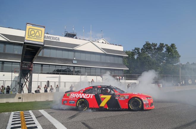 Justin Allgaier celebrates with a burnout after winning the NASCAR Xfinity Series Johnsonville 180.