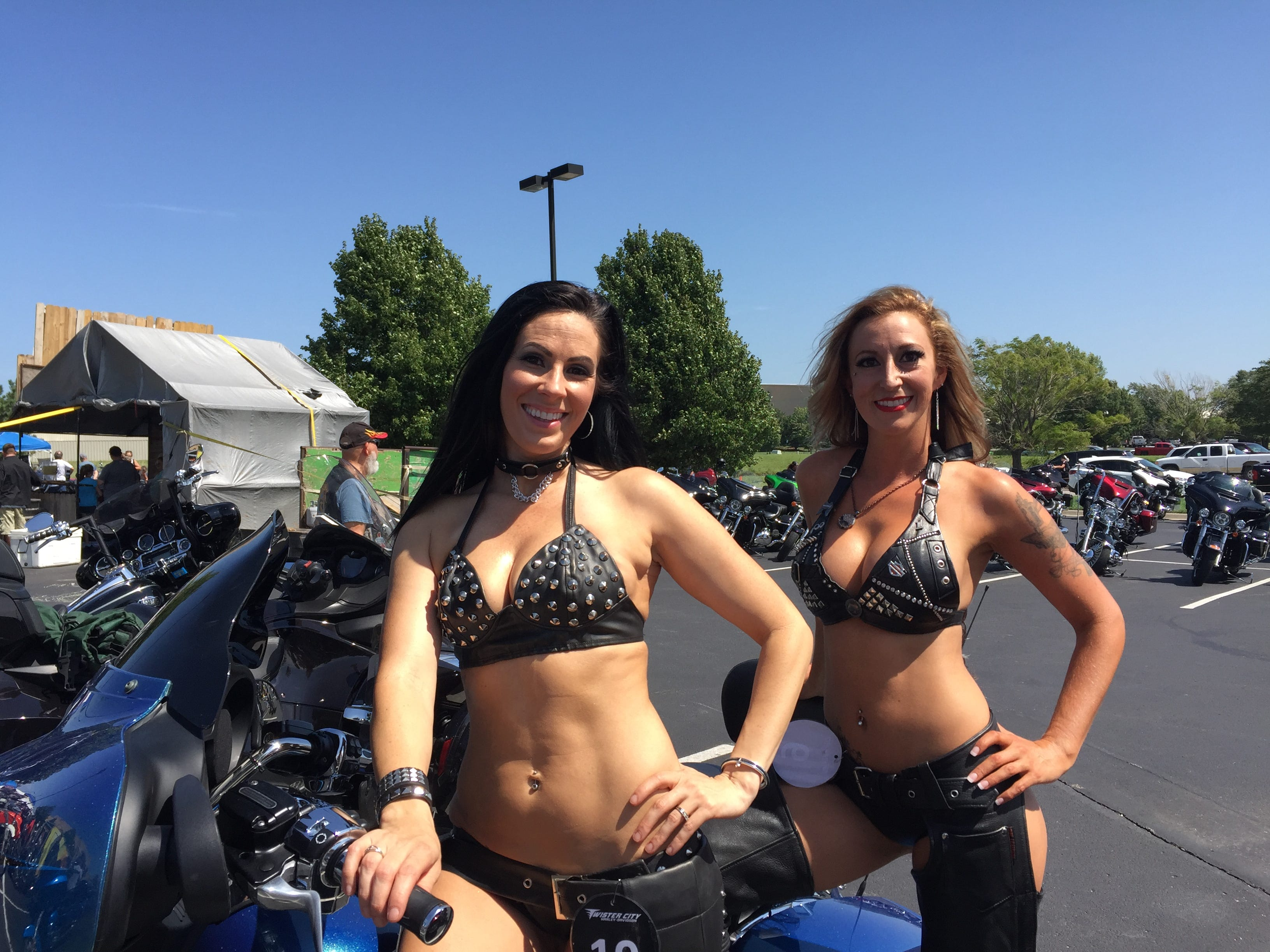 "Kim West-Peay (front) and Bridget Julius pose with a bike at the Twister City Harley-Davidson Dealership. They said nothing too cringe-y had happened by 11:30 a.m. – as in, no, ""Do you come with the bike?"" questions from male customers. But, ""wait a couple hours,"" Julius said. The beer hadn't yet started flowing freely."