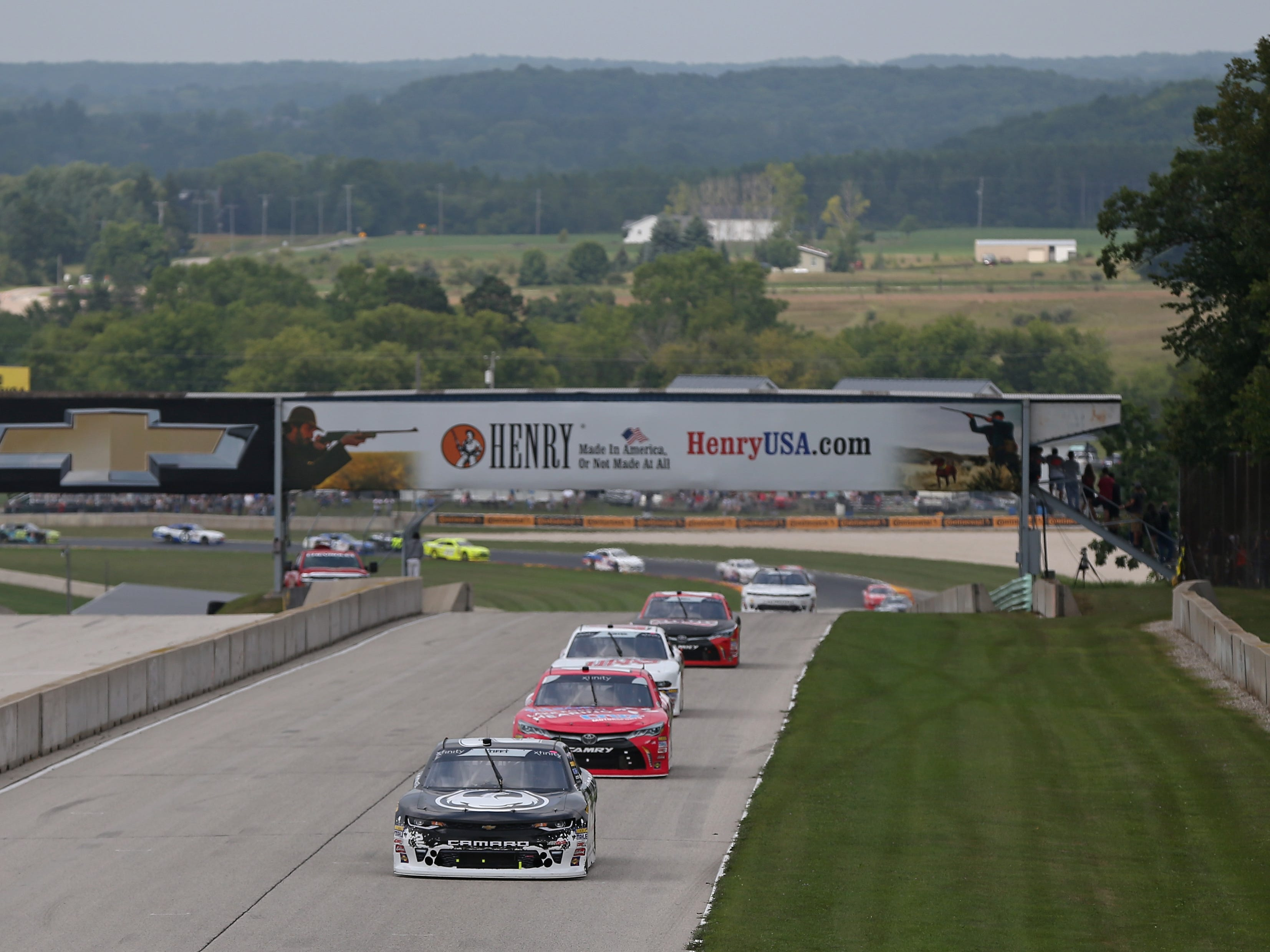 Matt Tifft leads the field past the start-finish line early during the Johnsonville 180 on Saturday.