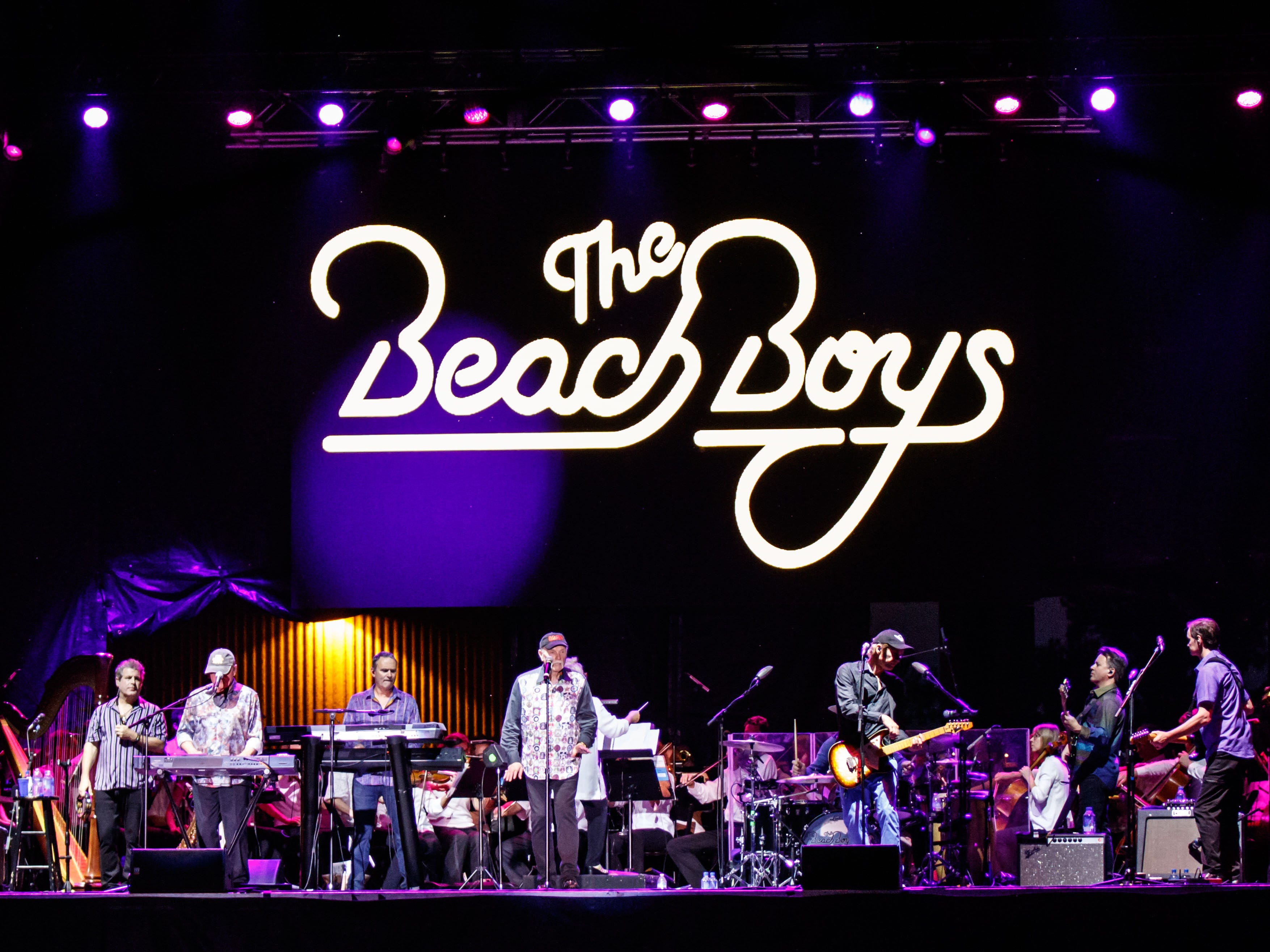 Musicians with The Southwestern Suburban Symphony perform with The Beach Boys at the Milwaukee County Sports Complex in Franklin on Saturday, August 25, 2018.