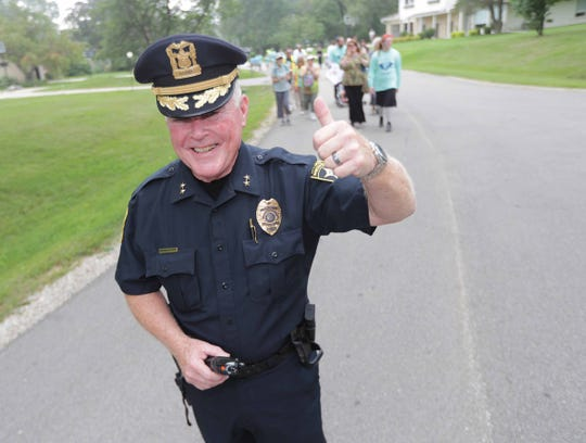 Bayside Police Chief Douglas Larsson gives the thumbs-up during the Walk4Friendship walk in August 2018. Larsson is implementing a new neighborhood policing initiative to strengthen relationships between police and the community.