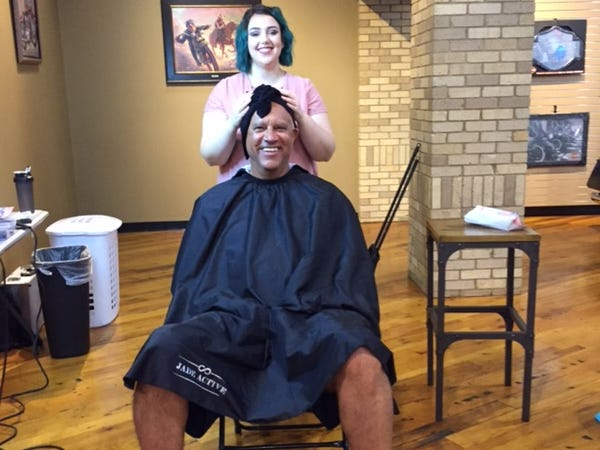"""Big Mike"" Hamilton gets a haircut and a scalp massage at the Twister City Harley-Davidson dealership welcome party Aug. 25."