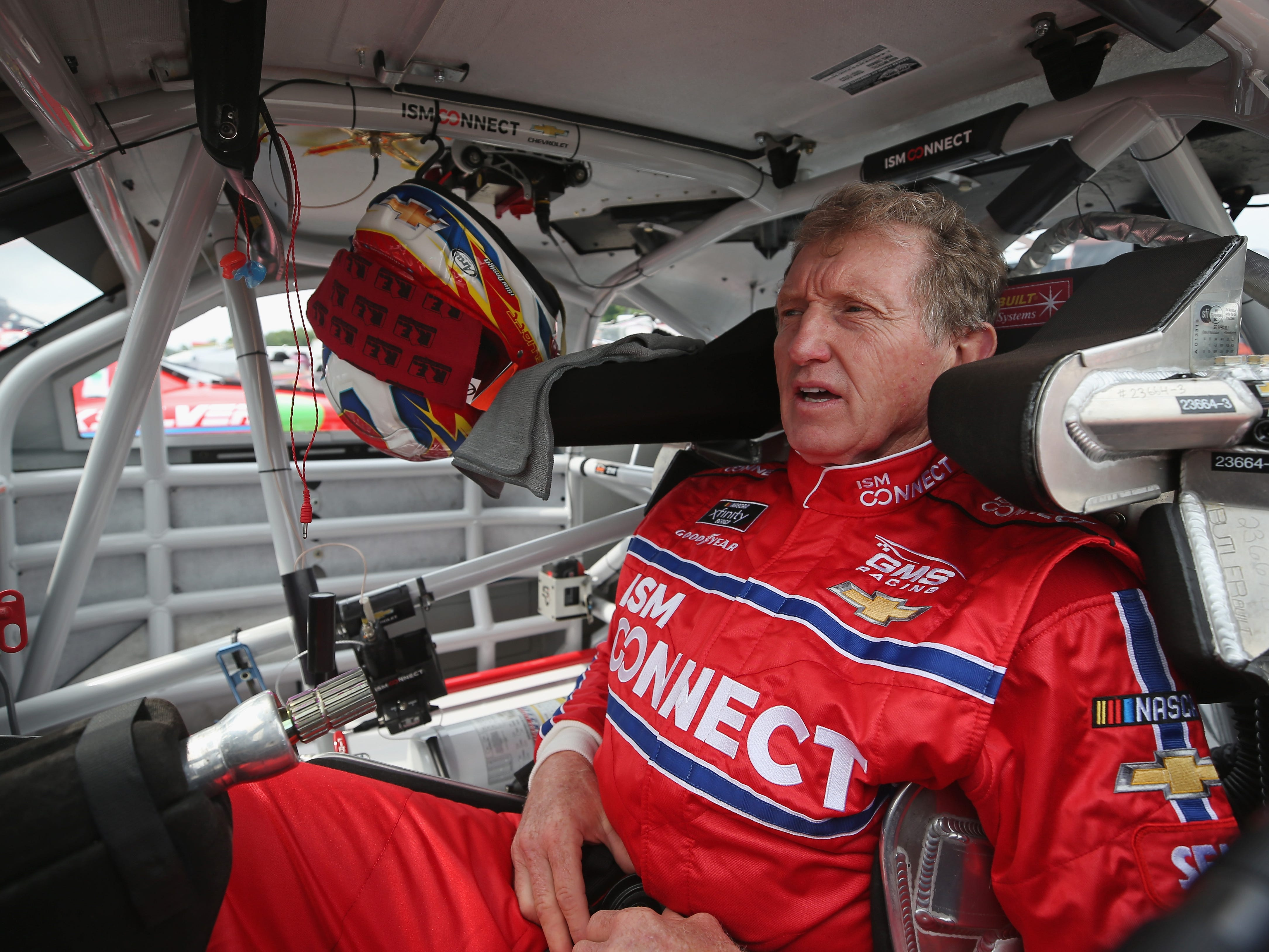 NASCAR Hall of Famer Bill Elliott gets into his car during qualifying for the Johnsonville 180 on Saturday at Road America.