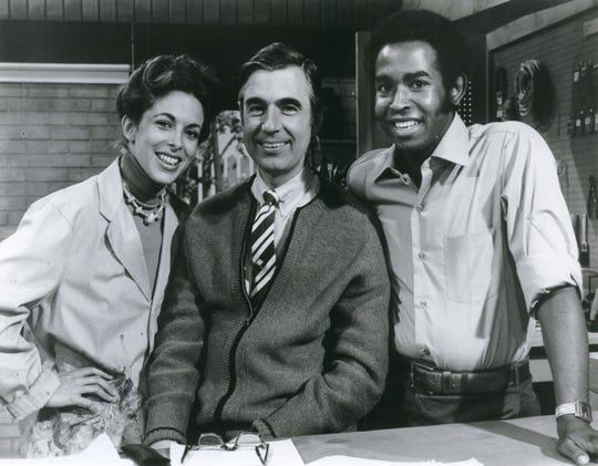 "Betty Aberlin and Francois Clemmons, regular cast members of ""Mister Rogers' Neighborhood,"" pose with host Fred Rogers in 1980."