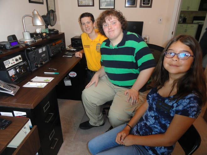 From left, Bryant Rascoll, Warren Whitby IV, and Marissa Robledo are members of the Montgomery Amateur Radio Club