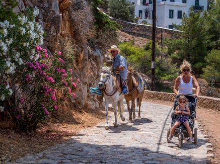 Tourists share the path with beasts of burden.