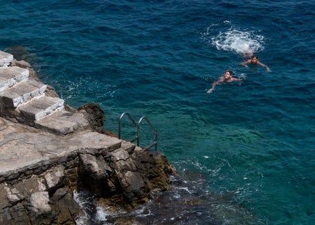 Swimming at restaurants in Hydra.