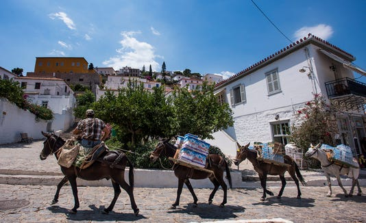 Pack animals carry loads up the hill in Hydra.