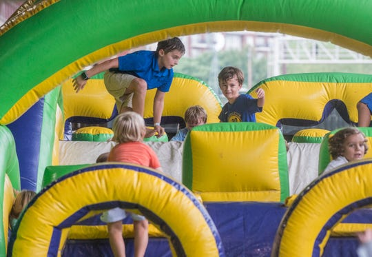Kids had fun playing on the inflatables. Hog Days of Summer returned for its second year at the Union Station Train Shed in Montgomery on Saturday, Aug. 18, 2018.