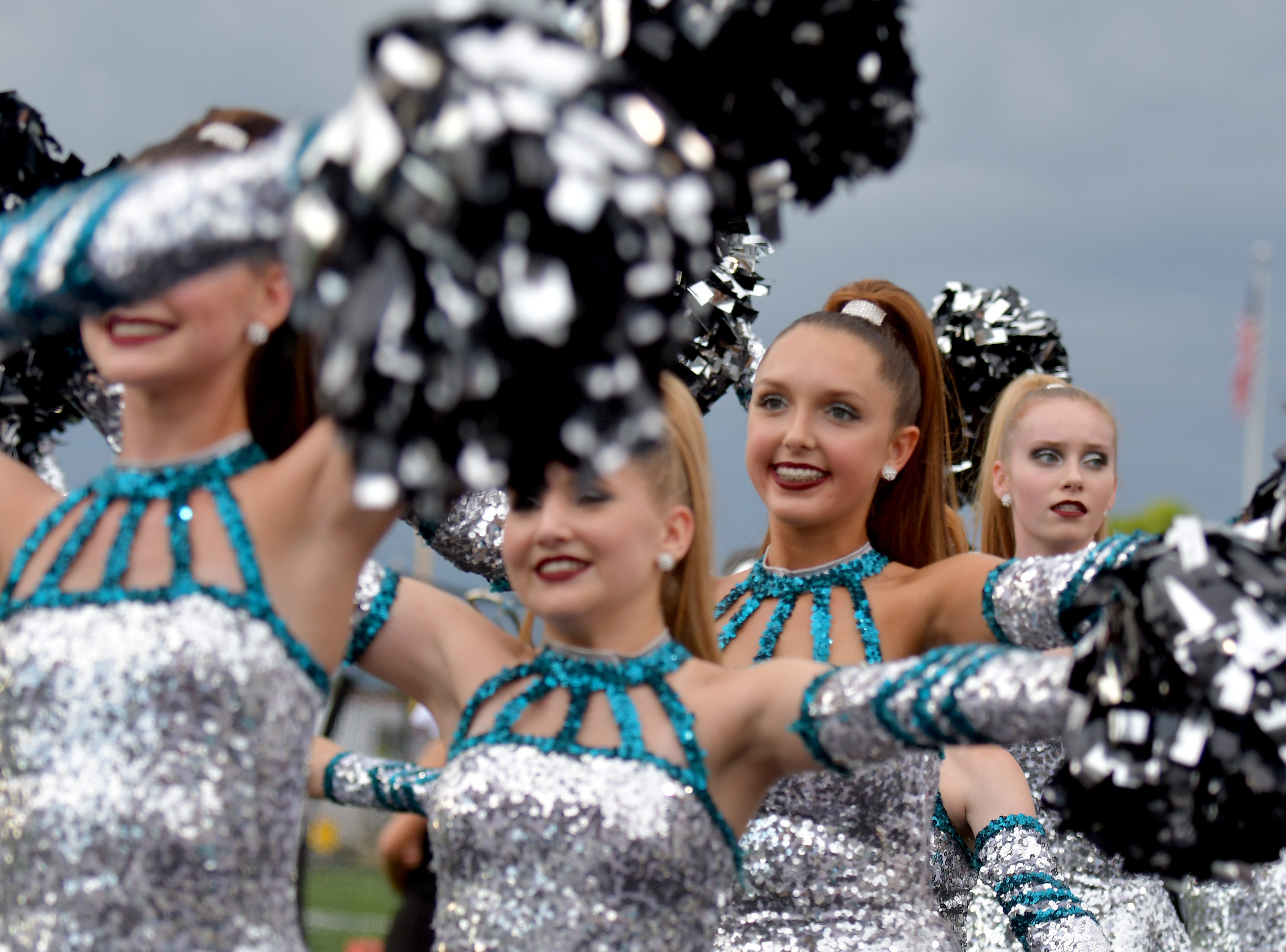 Members of the Gulf Coast High School band march onto the field before their game with Lely High School in Naples on Friday, Aug. 24, 2018.