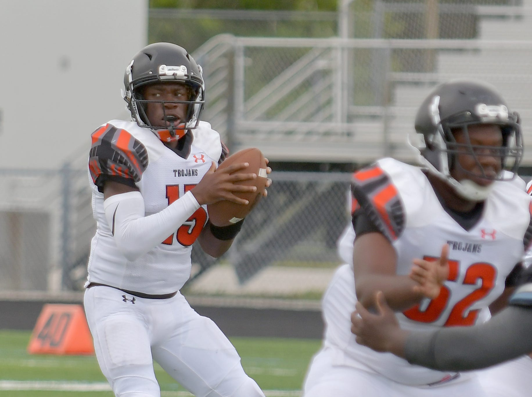 Lely High School quarterback Jonis Dieudonne (15) looks for an open man in their game with Gulf Coast High School in Naples on Saturday, Aug. 25, 2018.