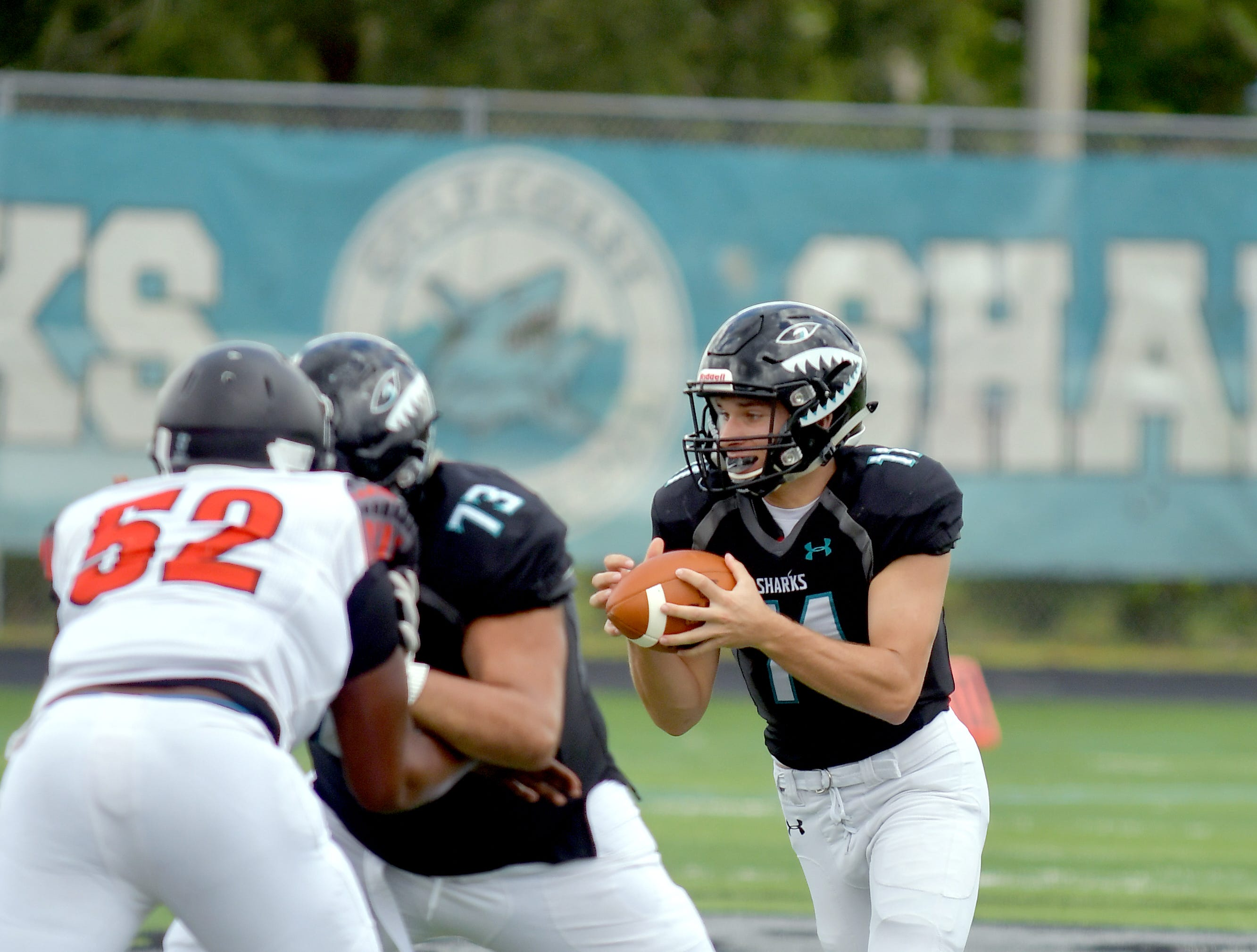 Gulf Coast High School quarterback Bryce St. Amand (14) during their game with Lely High School in Naples on Saturday, Aug. 25, 2018.