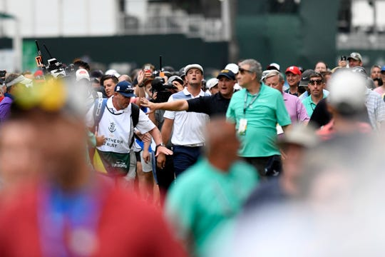 Bryson DeChambeau looks through the crowd to see his drive clear the trees on the 18th hole on his way to winning the Northern Trust PGA tour final in Paramus, NJ on Sunday, August 26, 2018.