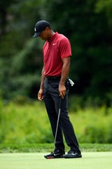 Tiger Woods reacts after his putt just misses the 11th hole during the final round of the PGA Northern Trust in Paramus, NJ on Sunday, August 26, 2018.