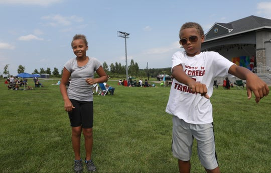 Jamil Perry, 9, and Tynaya Stewart, 11, both of Englewood  dance to the music on the speaker system at the Bergen Music Festival at Overpeck County Park in Ridgefield Park, Sunday, August 26, 2018.