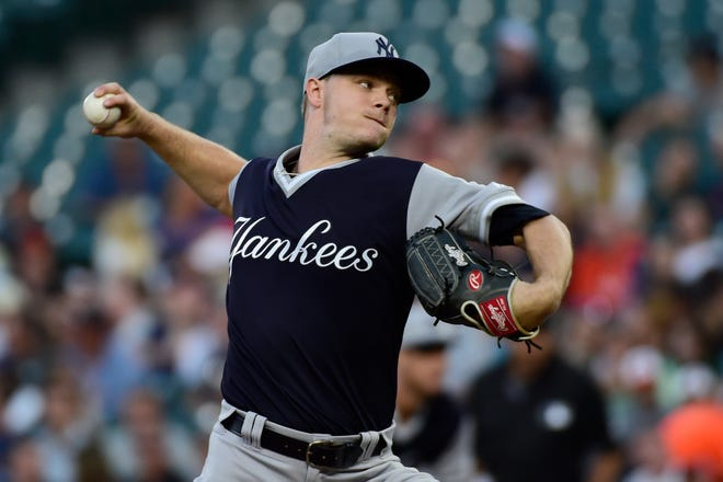 Aug 25, 2018; Baltimore, MD, USA; New York Yankees starting pitcher Sonny Gray (55) pitches during the first inning against the Baltimore Orioles at Oriole Park at Camden Yards.