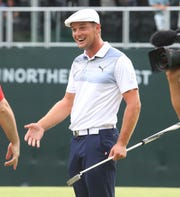 After sinking a putt on 18, Bryson DeChambeau celebrates as the winner of the PGA Northern Trust at the Ridgewood Country Club in Paramus, N.J.