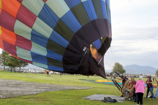 Hot air gives the balloon its lift.
