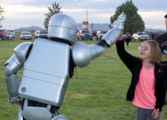 Alma Rae got a high-five from Power the Columbus Electric robot.