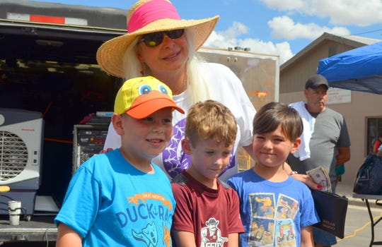 Blake Moore, 5, left, won the six-and-under Tortilla Toss on Saturday. Joining Moore were Cooper Shields, 4, second; and Mason Hagan, 5, third. Christy Ann Harvey is President of Deming MainStreet, sponsor for the event.